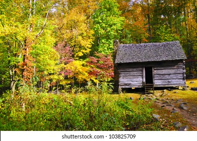 A log cabin surrounded by fall colors in the Great Smoky Mountain National Park