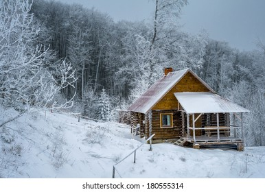 Log cabin the winter woods