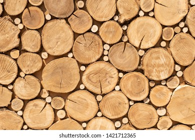 Log cuts close up. Stack of logs. close up. Logs cuts prepared for fireplace. Woodpile. Saw cuts design texture. Firewood background