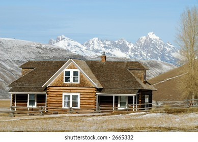 Log House with Grand Tetons in the background