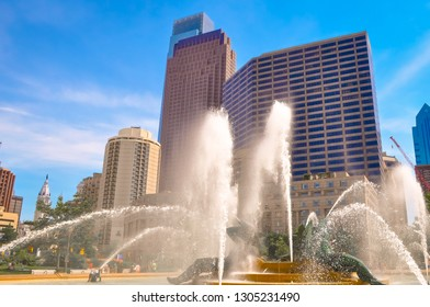 Logan Square Philadelphia, Pensilvania, USA with cityscape behind water from a fountain on a sunny summer day. Famous city's skyline downtown Philly.