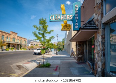 LOGAN, UTAH, UNITED STATES - AUGUST 31, 2018: Vintage commercial sign of a dry cleaning shop in the commercial district of Logan, Utah