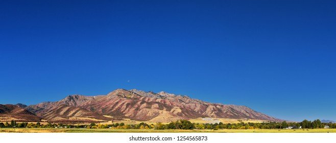 Logan Valley landscape views including Wellsville Mountains, Nibley, Hyrum, Providence and College Ward towns, home of Utah State University, in Cache County a branch of the Wasatch Range of the Rocky