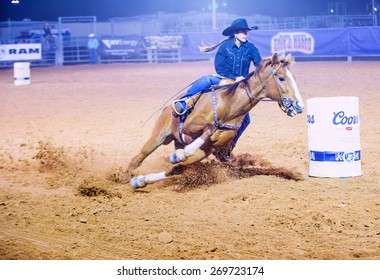 LOGANDALE , NEVADA - APRIL 10 : Cowgirl Participating in a Barrel racing competition in the Clark County Fair and Rodeo a Professional Rodeo held in Logandale Nevada , USA on April 10 2015