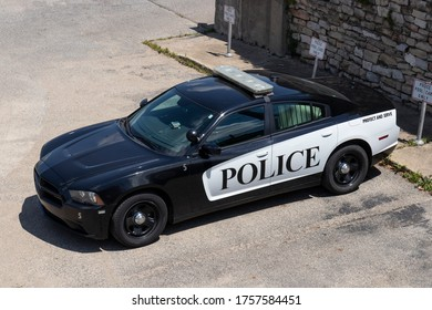 Logansport - Circa June 2020: Police cars with the words Protect and Serve. Actions by the police have resulted in calls to defund police departments.