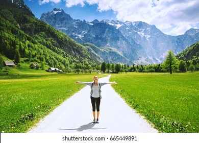 Logar valley or Logarska dolina, Slovenia, Europe. Hiking woman on nature background with Alps and mountain valley. Hiker girl in mountains. Photo of travel, inspiration, freedom, healthy lifestyles