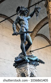 Loggia Dei Lanzi in a large city called in Italy called Florence where Roman sculptures are near the town hall of Florence. This statue is one of many called Perseus