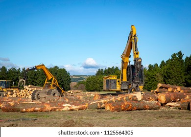 Logging machines on site shift and stack logs