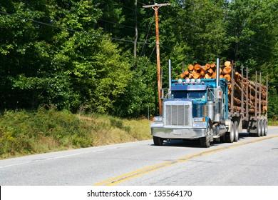 Logging truck on highway near Skohegan, Maine