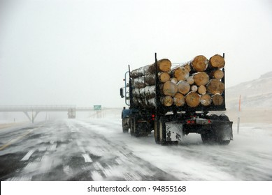 Logging truck on icy road  during winter storm in Eastern Oregon