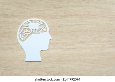 Logical thinking concept : Electronic circuit with IC or Integrated circuit as human brain in outline head, depicts the mental process in which one uses reasoning consistently to come to a conclusion