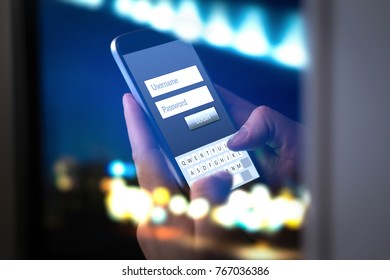 Login with smartphone to online bank account or personal information on internet at night. Hands typing and entering username and password to an application in dark. Cyber security, phisning concept.