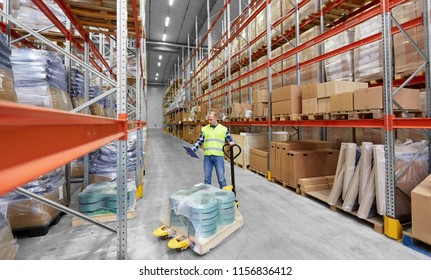 logistic business, shipment and loading concept - male worker with loader and clipboard at warehouse