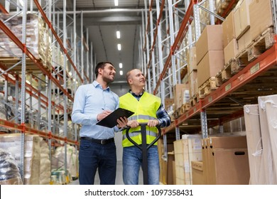 logistic business, shipment and people concept - businessman with clipboard and warehouse worker with loader