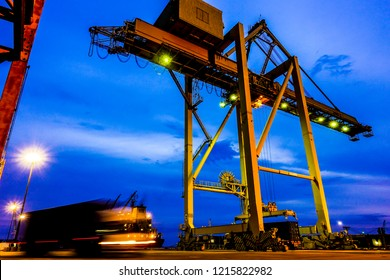 Logistic and Seaport, Shipping yard and loading with working crane bridge at shipyard, Container ship in export  import, business and logistics