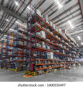 logistic shed and distribution boxes workers and forklift in operation