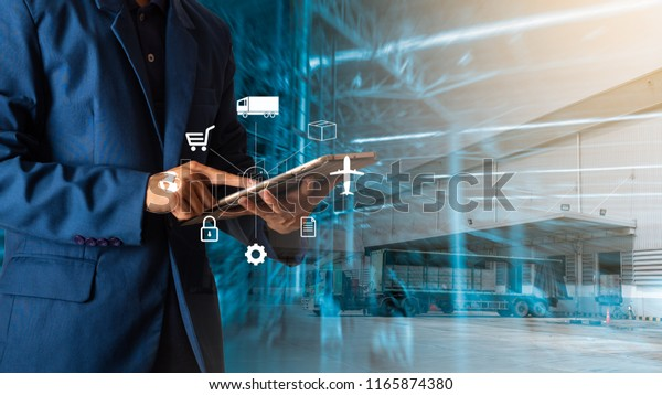 Logistic and transport concept : Businessman manager using tablet check and control and planning for Modern Trade warehouse logistics.
