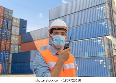 Logistic worker engineer man working in cargo container, wearing a face mask in warehouse industry factory site. Export, import concept. Business people lifestyle. Corona virus and health care concept