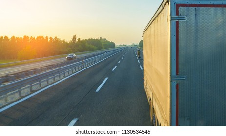 Logistics background, rear view of truck on motorway