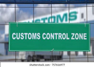 Logistics complex behind the green sign, customs control zone.