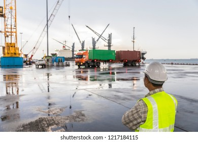 Logistics concept, foreman working with tablet, Cargo Freight Shipping for import export, container boxes at cargo, Logistics Industry, selective focus