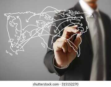 Logistics concept, man drawing the world map