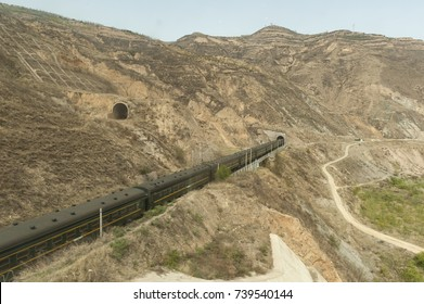 Logistics, railways system, trains travel trough tunnel in Xinjiang,  China.