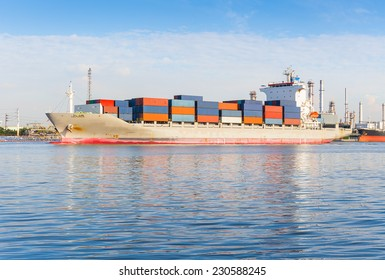 Logistics and transportation of cargo ship and cargo container working with crane at port for logistics and transportation background.