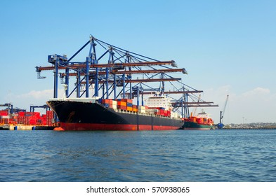 Logistics and transportation concept. Large cargo freight ship loading containers at the port
