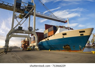 Logistics and transportation of Container Cargo ship with working crane bridge in seaport. ,unloading of merchant ships