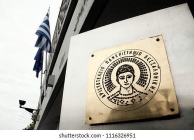 Logo of Aristotle University of Thessaloniki outside of  headquarters of University in Thessaloniki, Greece on 9 Oct. 2013.