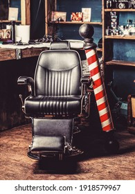 Logo of the barbershop, symbol. Stylish vintage barber chair. Hairstylist in barbershop interior. Barber shop chair. Barbershop armchair, salon, barber shop for men. Barber shop pole.