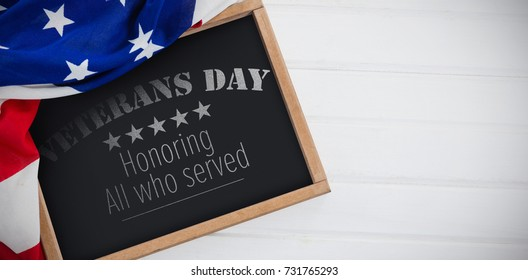 Logo for veterans day in america  against american flag and slate on table