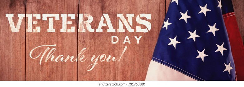 Logo for veterans day in america  against american flag on a wooden table