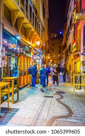 LOGRONO, SPAIN, OCTOBER 28,2014: People are strolling a street in Logrono during night
