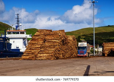 Logs, freight ship and lorry on Campbeltown Harbour