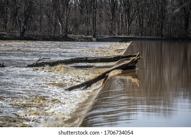 logs stuck on the dam Providence park Maumee river  - Shutterstock ID 1706734054