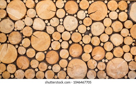logs wooden log houses neatly stacked as a background and natural texture
