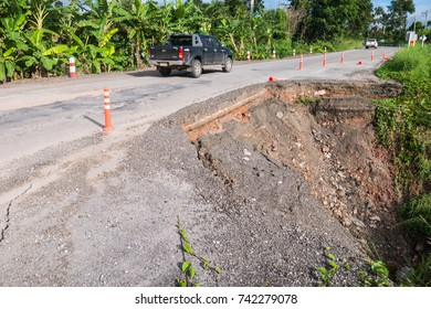 LOIE, THAILAND - OCTOBER 17: Cars drive on high way damage road have big hole near abyss  in Loie , Thailand on October 17, 2017.