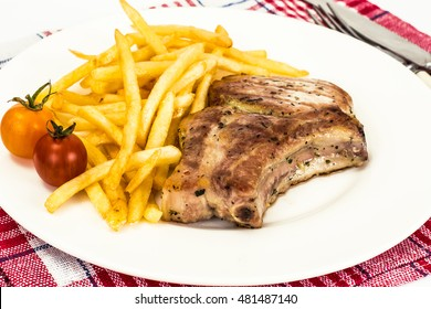 Loin Roast with Potatoes Fries on White Studio Photo