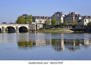 Loire river and Cessart bridge at Saumur, commune in the Maine-et-Loire department , Pays de la Loire region in western France.