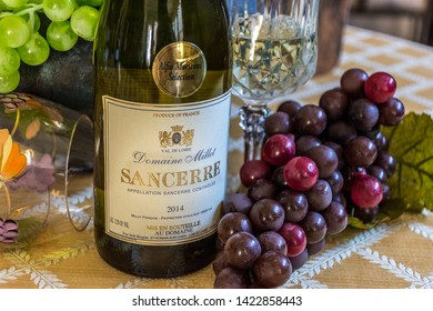 Loire valley / France —September 20, 2017: Sancerre White Wine Plus Grapes