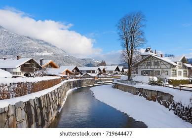 loisach river flowing through garmisch-partenkirchen, idyllic winter landscape bavaria