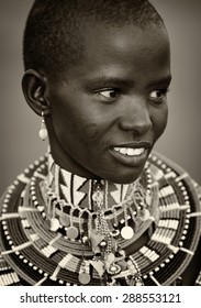 LOITOKTOK - KENYA - JANUARY 5, 2015: Unidentified young beautiful Maasai woman with traditional necklace poses for a portrait on January 5, 2015 in Loitoktok, Kenya.