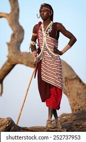 Loitoktok - KENYA - JANUARY 9, 2015: Unidentified Maasai warrior with traditional headdress and necklace on January 9, 2015 in Loitoktok, Kenya.