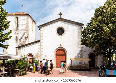 Loix-en-Re, France - August 7, 2018: View of the church of the village. The words Liberte, Egalite, Fraternite, freedom, equality, fraternity, are written in the arch.