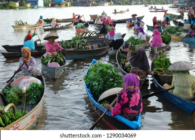 Lok Baintan, South Borneo, Indonesia, Circa 2010: The limited road transportation pushes thus people held this traditional floating market. This market is only held in the early morning after dawn.
