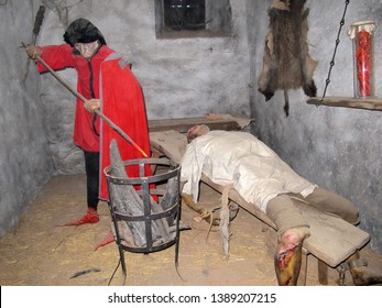 LOKET CASTLE, CZECH REPUBLIC - 25 JULY 2018 - Editorial: Torture with hot iron. Exhibition of medieval torture practices