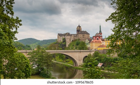 Loket Castle on the Eger River. Romantic castle with colourful houses. Knight's castle in Czech Republic