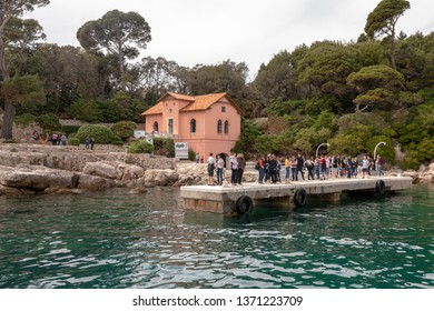 Lokrum Island, Dubrovnik in Croatia - april 2019: Tourists waiting for the ferry, Forest rangers house in the background.